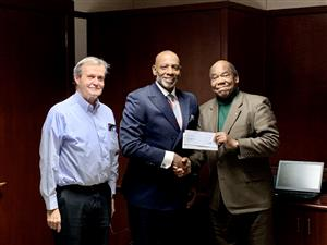 Dr. Anthony Jackson presents $2,000 to begin to Allen Jackson Scholarship Fund.